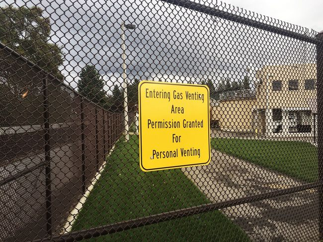 Safety Protection Fence Chainlink Fence Security Western Script Text Warning Sign Yellow Forbidden Communication Sign Close-up Sky Wire Mesh Outdoors Focus On Foreground Day Symbol No People Gas Funny Humor Idaho EyeEm Gallery