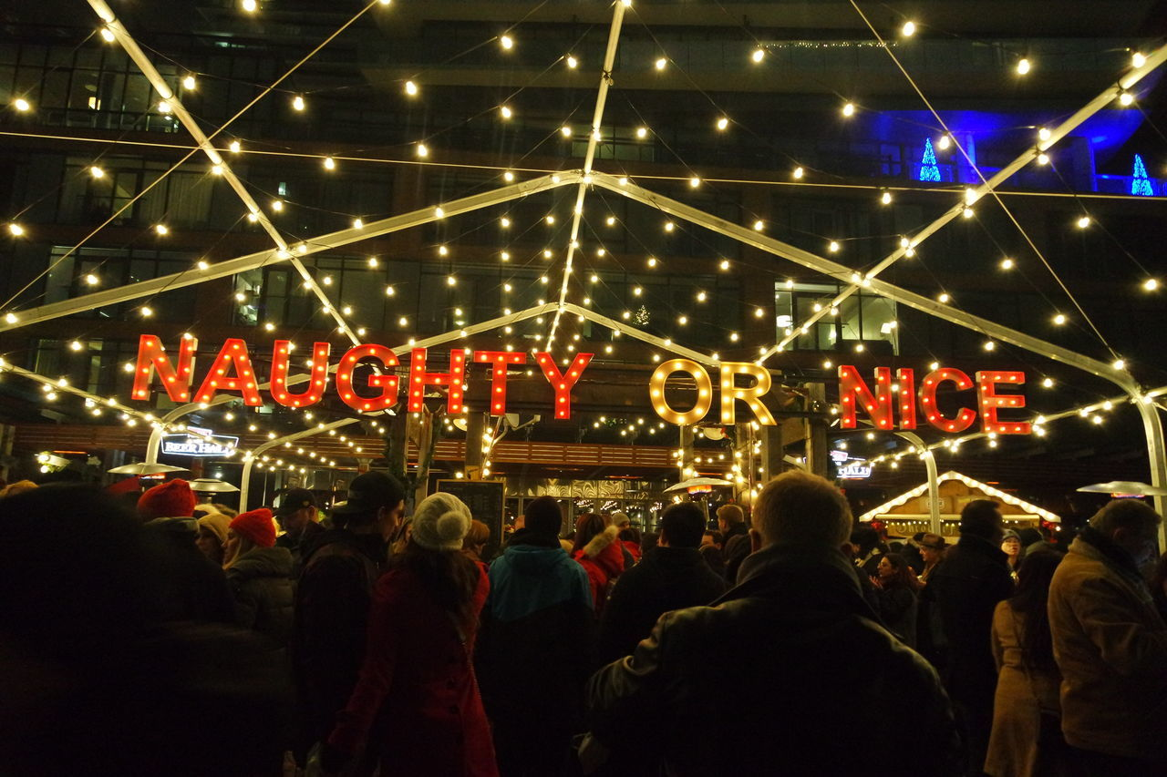 Naughty or Nice 😉Arts Culture And Entertainment City City Life City Street Distillery District Illuminated Large Group Of People Lights Men NAUGHTY Or NICE  Night Street Toronto Christmas Market The Street Photographer - 2016 EyeEm Awards Cities At Night The Following 43 Golden Moments Feel The Journey Beautifully Organized