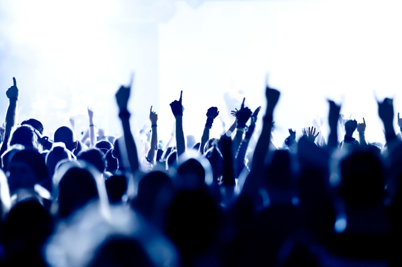 silhouettes of concert crowd in front of bright stage lights Applauding Band Cheerful Clap Club Concert Crowded Disco Entertainment Event Fan Festival Group Happy Light Live Music Musician Night Popular Rock Show Sound Stage Youth