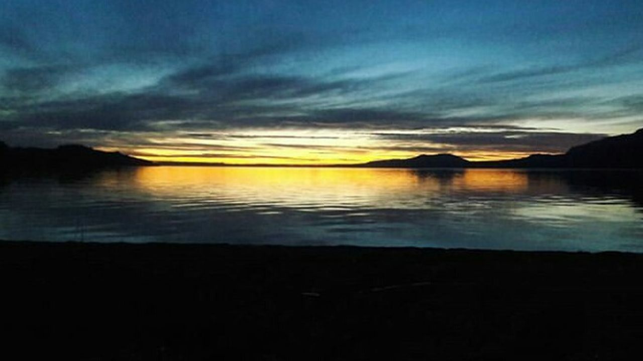 reflection, cloud - sky, sky, sunset, scenics, tranquil scene, water, nature, outdoors, no people, silhouette, sea, beauty in nature, horizon over water, day