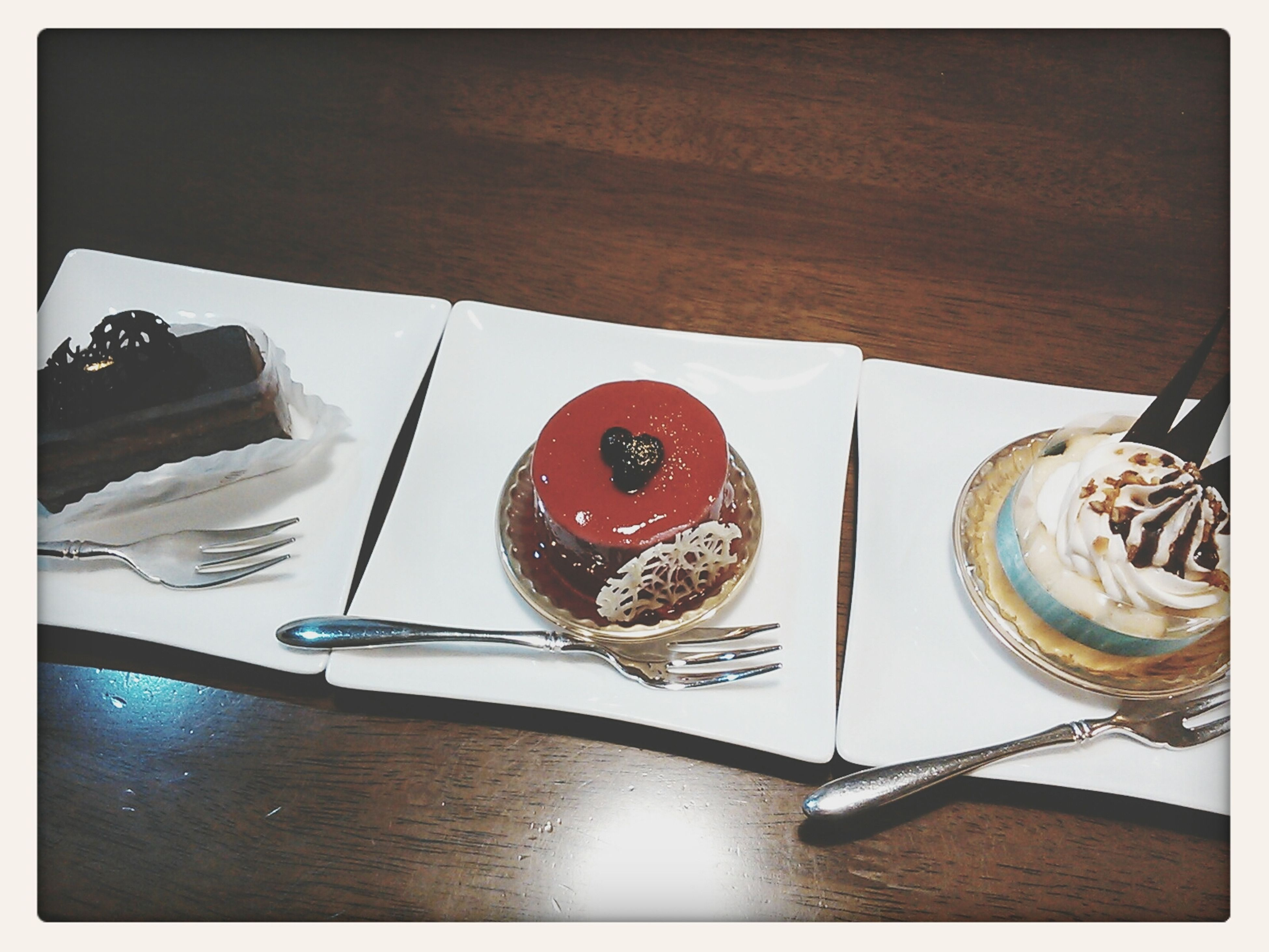 indoors, still life, food and drink, transfer print, table, sweet food, high angle view, auto post production filter, food, dessert, plate, cake, close-up, indulgence, fork, no people, freshness, ready-to-eat, directly above, spoon