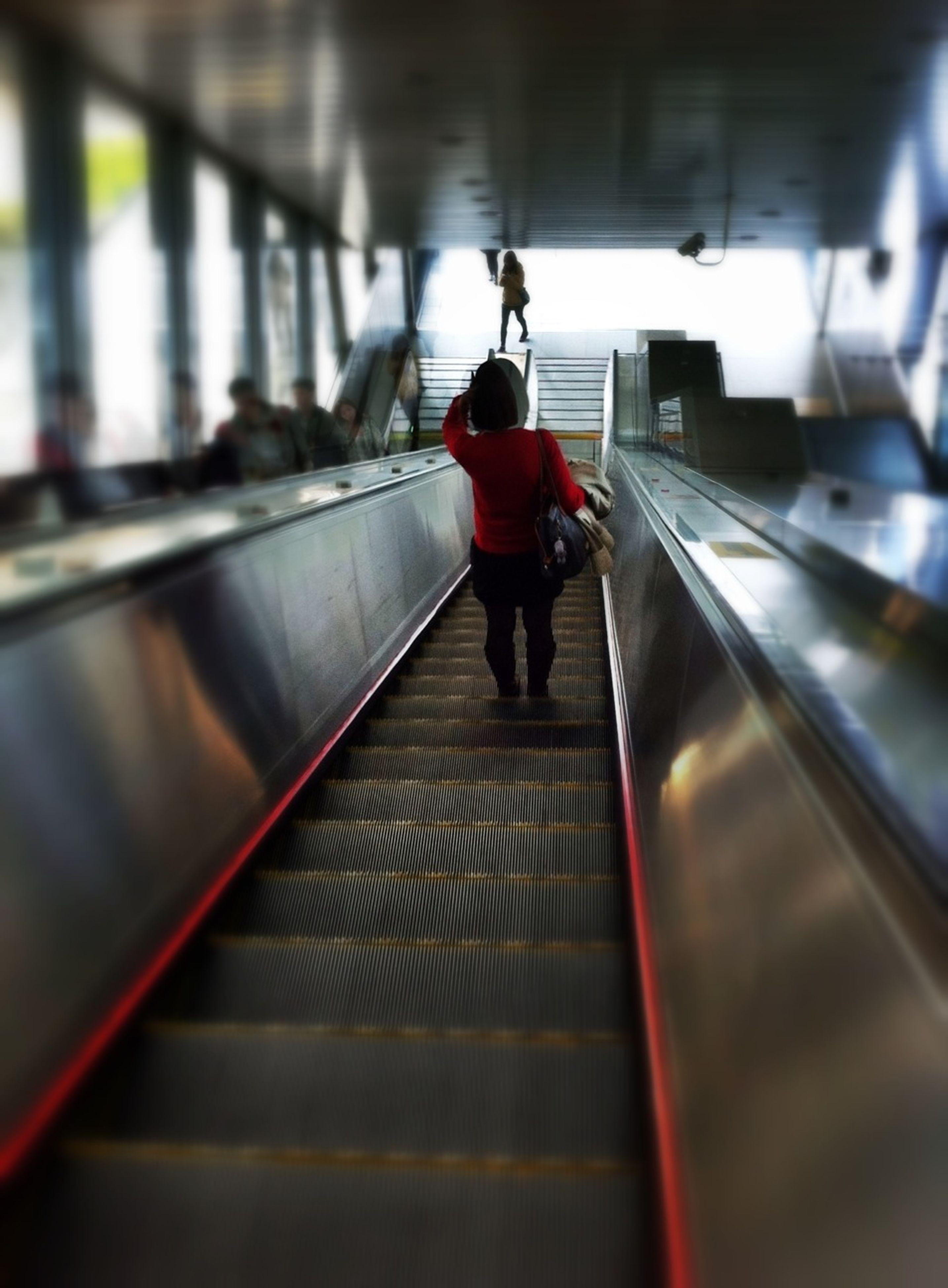 indoors, full length, lifestyles, transportation, escalator, walking, men, rear view, motion, the way forward, railing, on the move, subway station, illuminated, subway, blurred motion, travel, railroad station