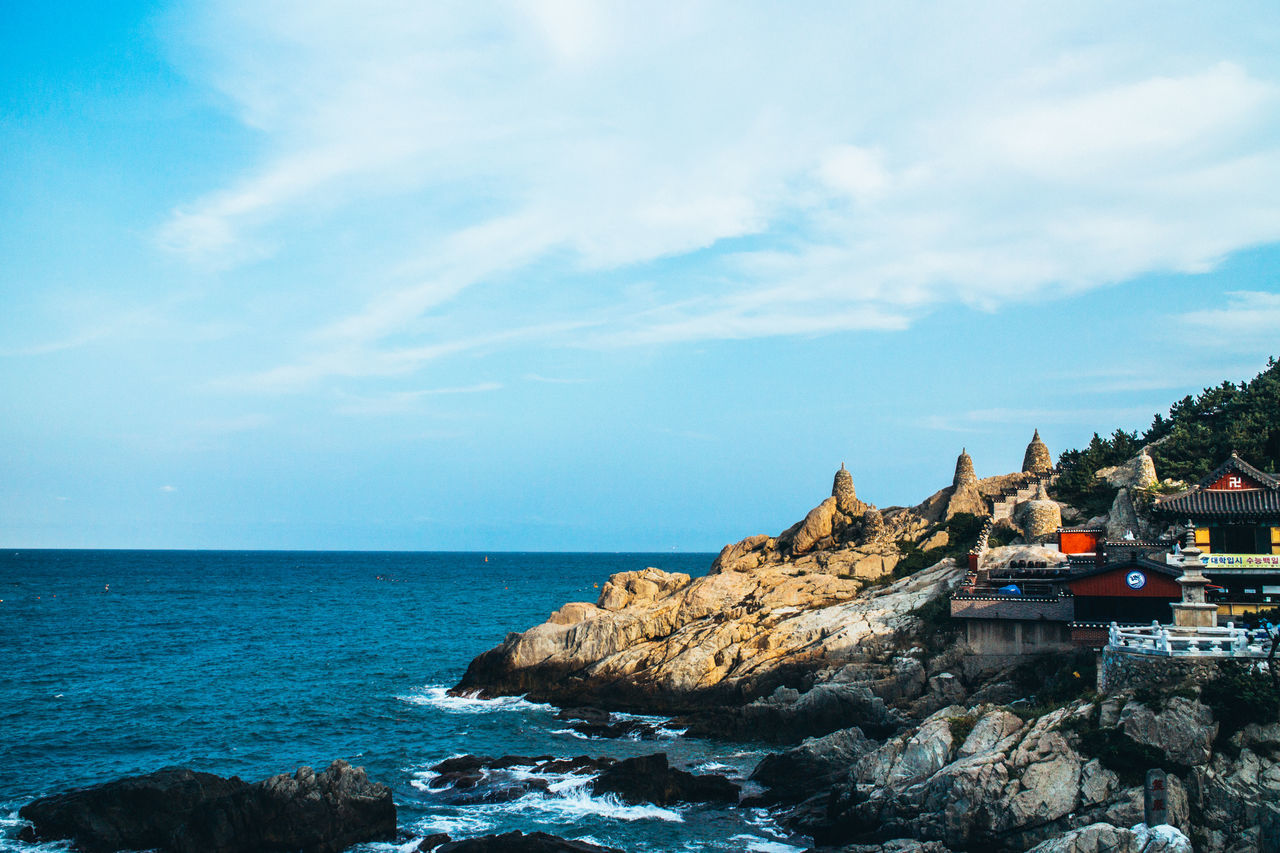 Beauty In Nature Blue Sky Cloud - Sky Day Nature Rock Formation Rocky Scenics Sea Sky Temple Temple - Building Temple Of Sea Tranquil Scene Tranquility Travel Photography Traveling Wave