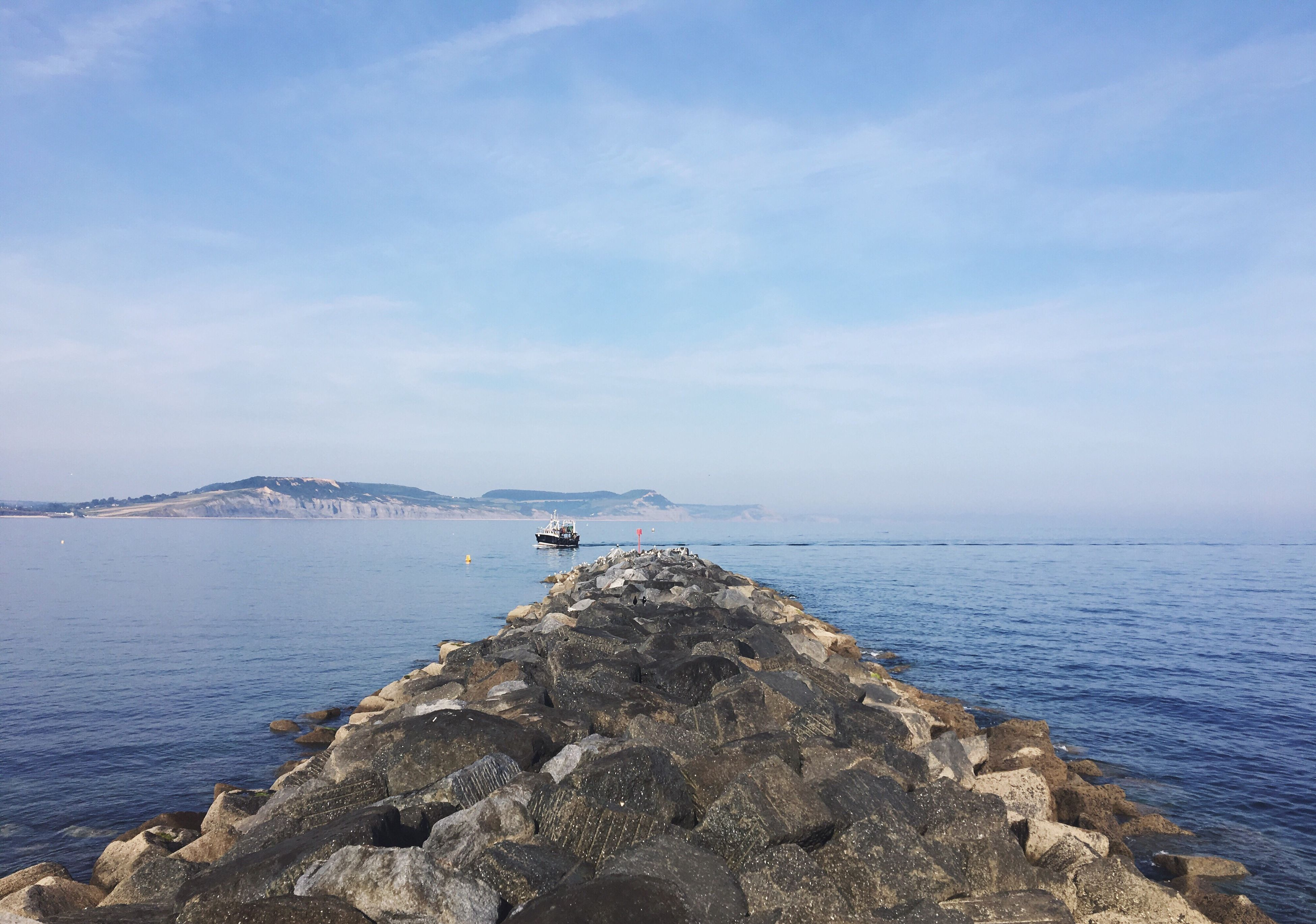 sea, water, nature, scenics, beauty in nature, outdoors, rock - object, tranquil scene, day, sky, tranquility, no people, blue, horizon over water, groyne