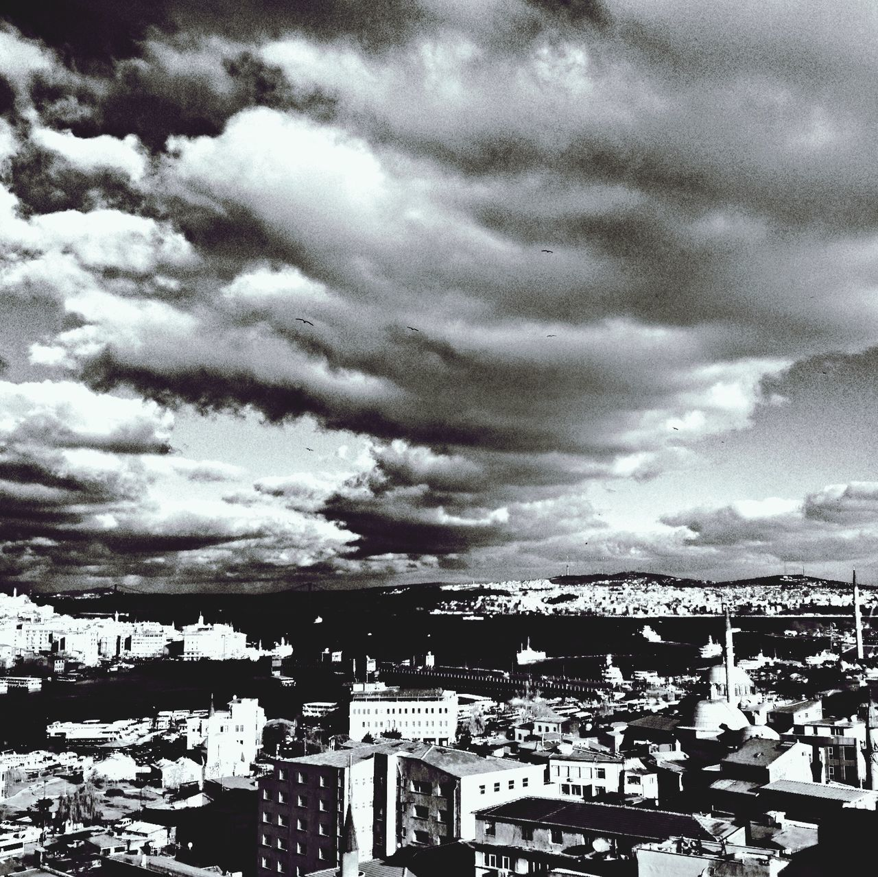 cloud - sky, architecture, sky, built structure, building exterior, weather, outdoors, day, cityscape, residential building, city, no people, nature