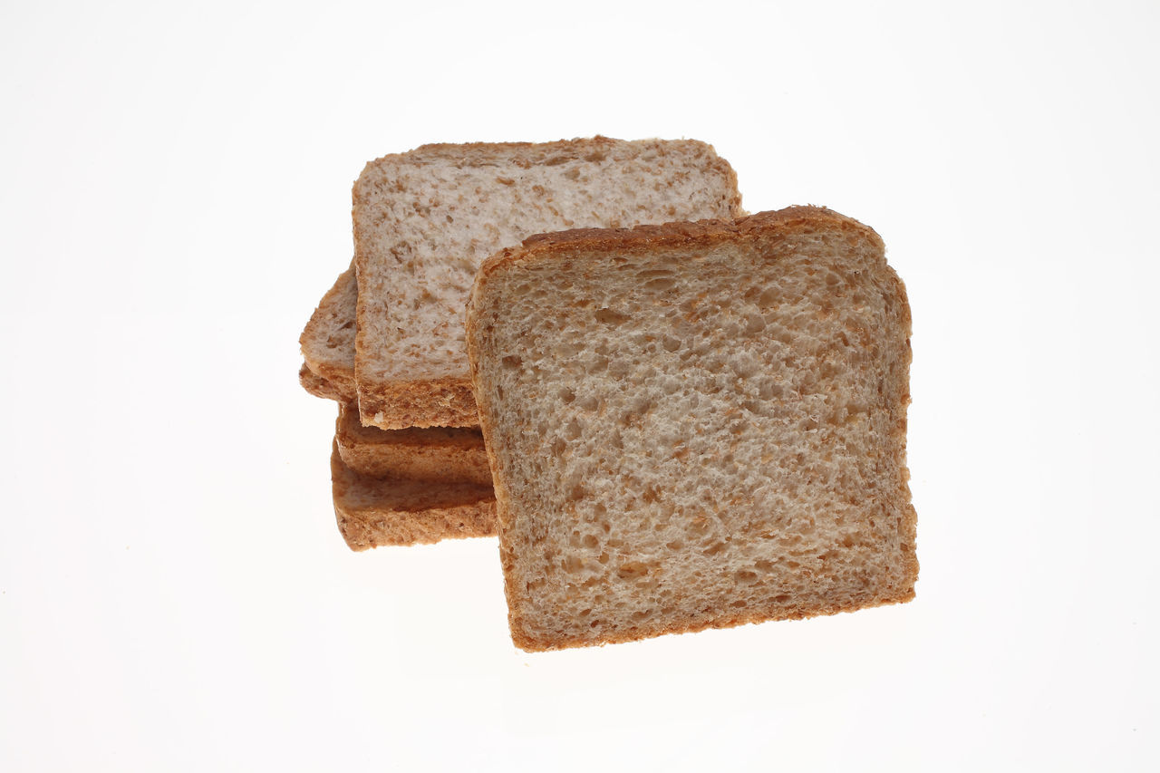 slices of Wholemeal toast bread on white Bread Brown Close-up Cut Out Indulgence No People Slices Studio Shot Toastbread Toast🍞 White Background Wholemeal Wholemeal Bread  Wooden