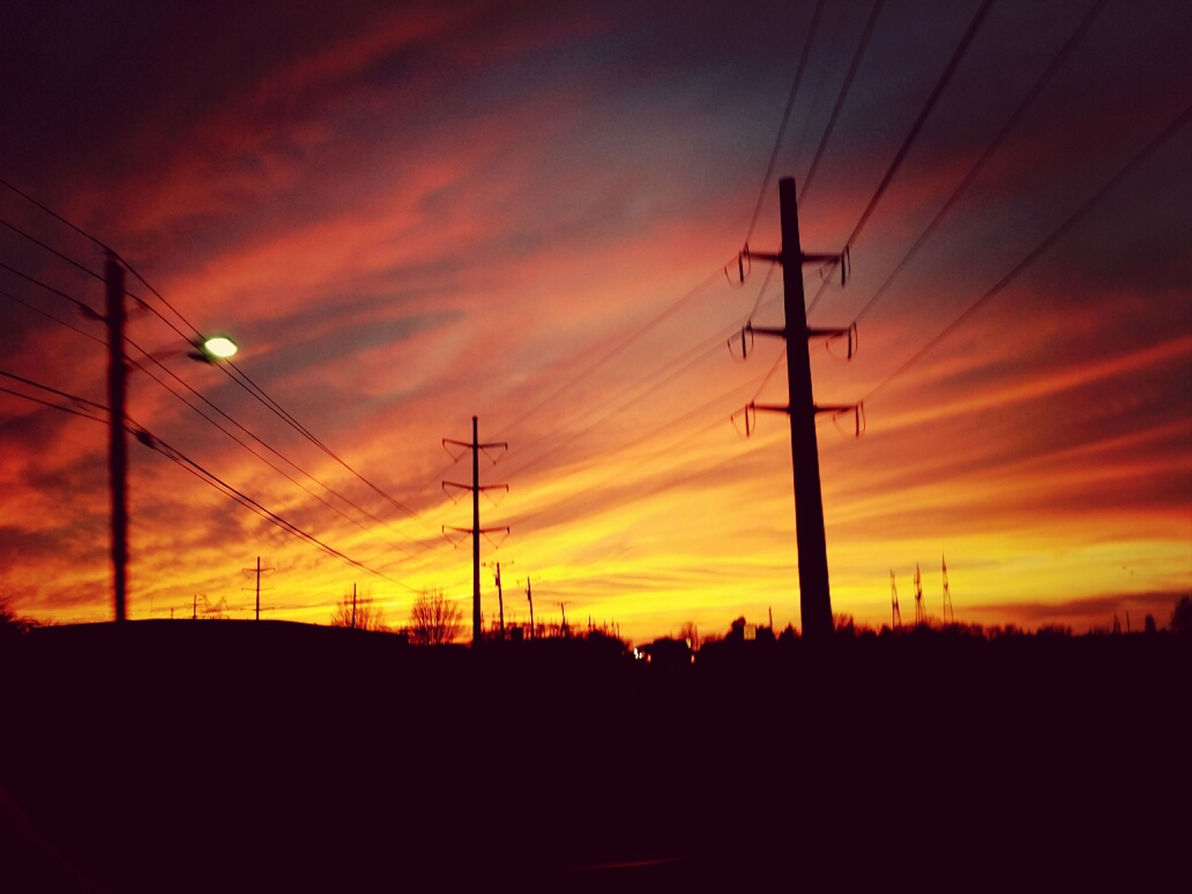 sunset, silhouette, orange color, sky, electricity pylon, power line, scenics, electricity, beauty in nature, tranquility, power supply, tranquil scene, cloud - sky, connection, nature, dramatic sky, landscape, cable, idyllic, fuel and power generation