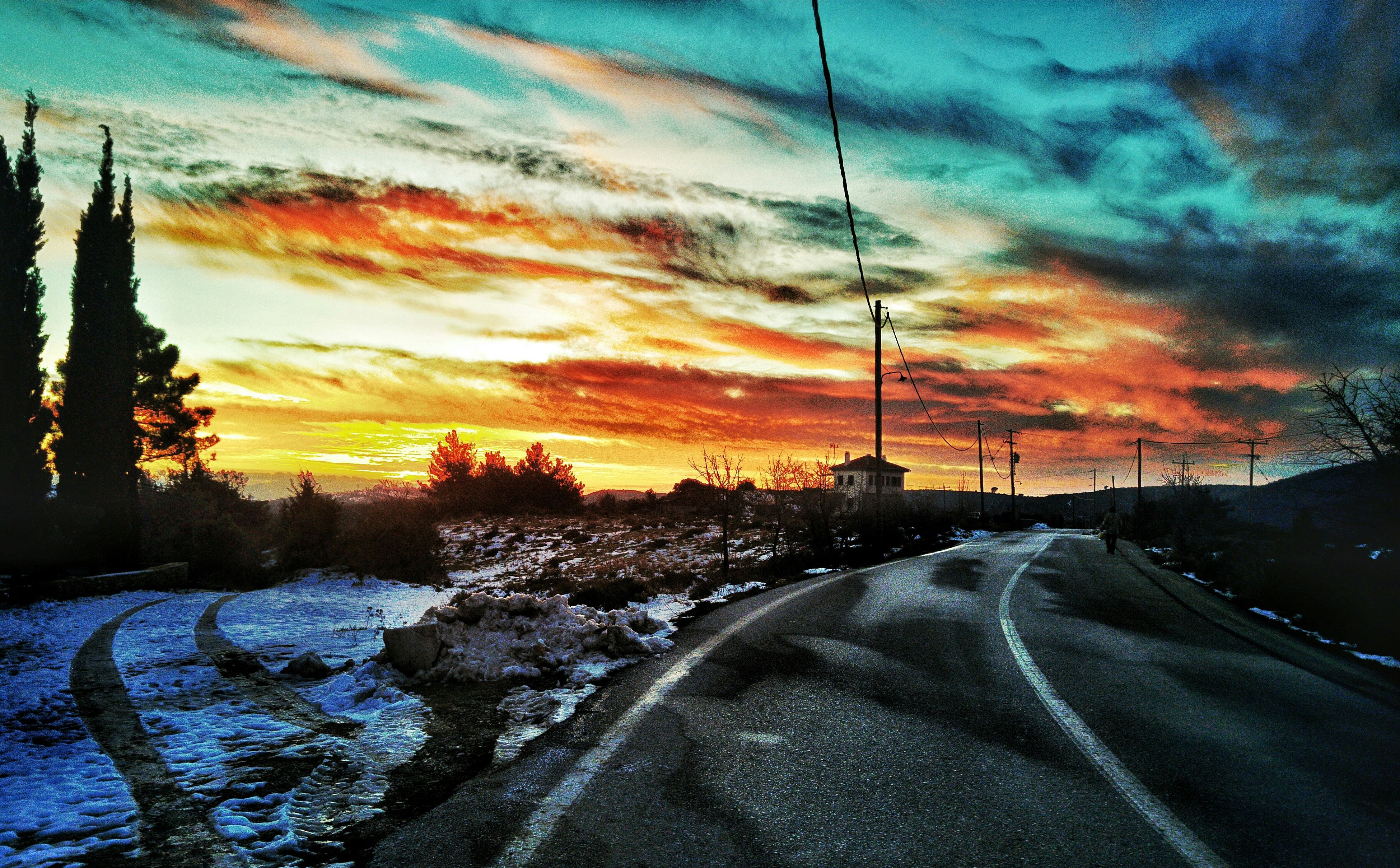 sunset, sky, cloud - sky, snow, cold temperature, weather, winter, season, beauty in nature, scenics, tranquility, orange color, the way forward, tranquil scene, nature, cloudy, dramatic sky, road, cloud, covering