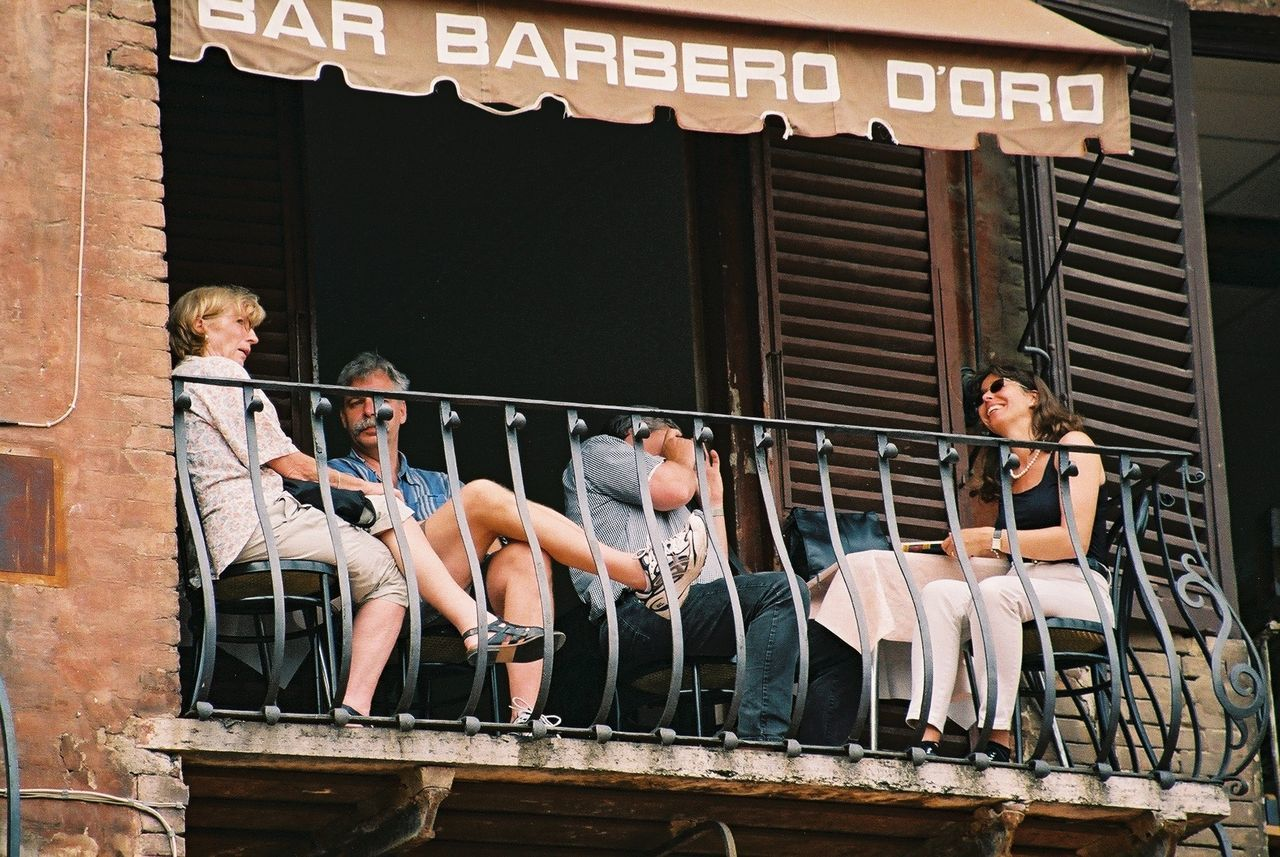 Bar Barbero Doro overlooking Piazza del Campo Bar Built Structure Casual Clothing Composition Full Frame Full Length Incidental People Italy Leisure Activity Lifestyles Outdoor Photography Piazza Del Campo Siena Terrace Text Togetherness Tourist Attraction  Tourists Wall - Building Feature