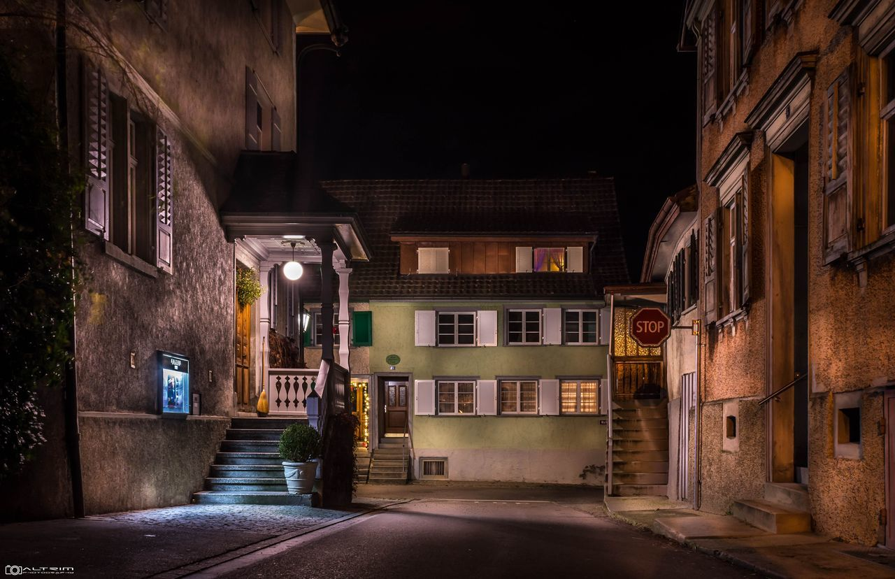 architecture, building exterior, built structure, night, illuminated, street, the way forward, house, alley, empty, no people, residential building, outdoors, road, sky