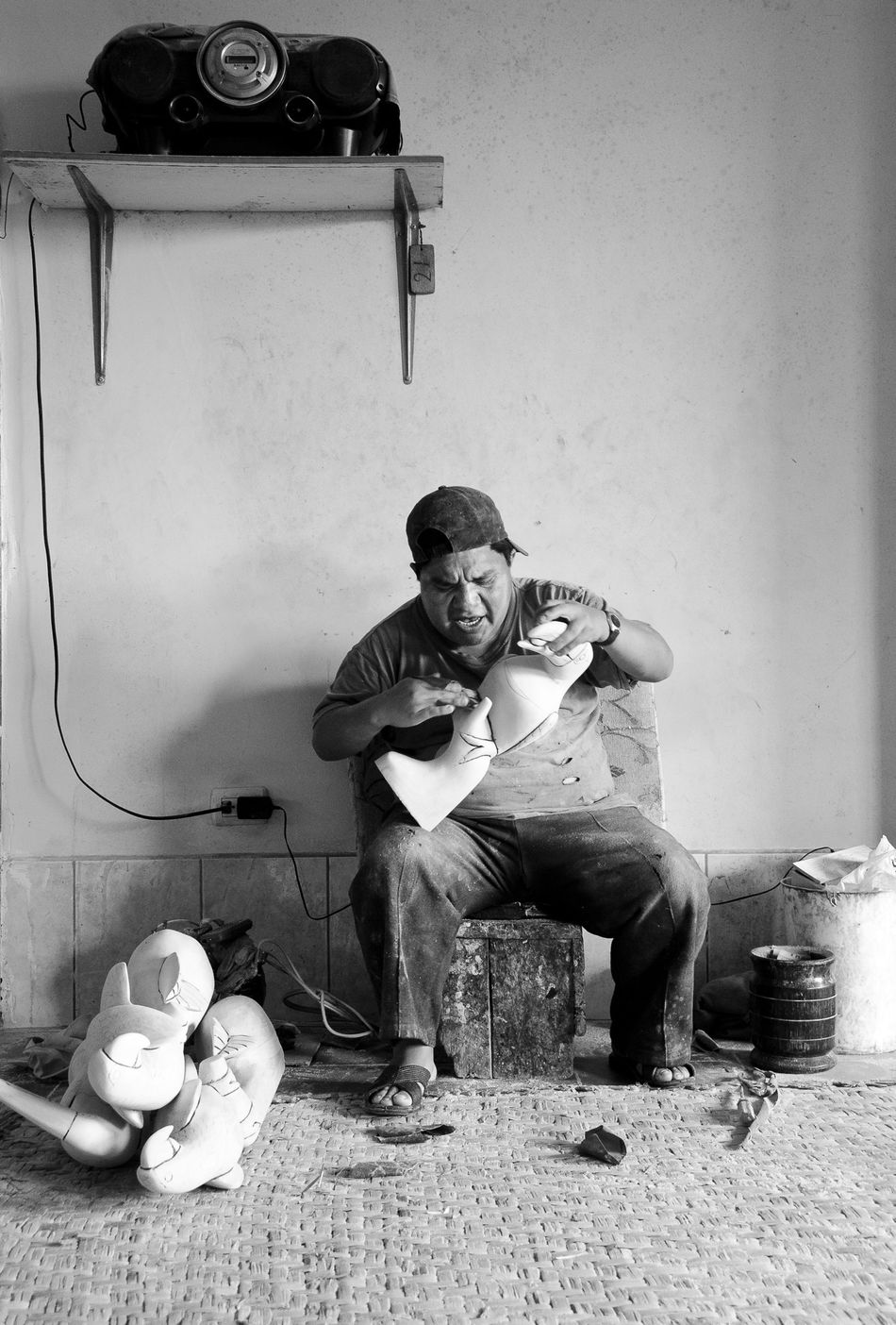 This man was singing loud by making a wooden parrot- wonderful to watch :) People People Photography Showcase: February Black & White Blackandwhite Photography Black And White Black&white Blackandwhite Singing Radio People Singing Wood Art Wood Working Man Parrot Telling Stories Differently Human Meets Technology The Portraitist - 2016 EyeEm Awards