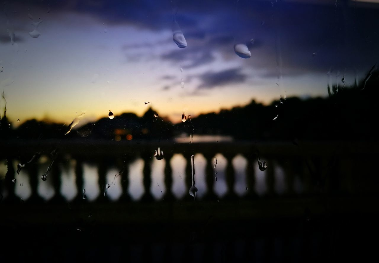 water, reflection, drop, sunset, no people, wet, nature, sky, window, silhouette, cloud - sky, close-up, raindrop, outdoors, beauty in nature, day