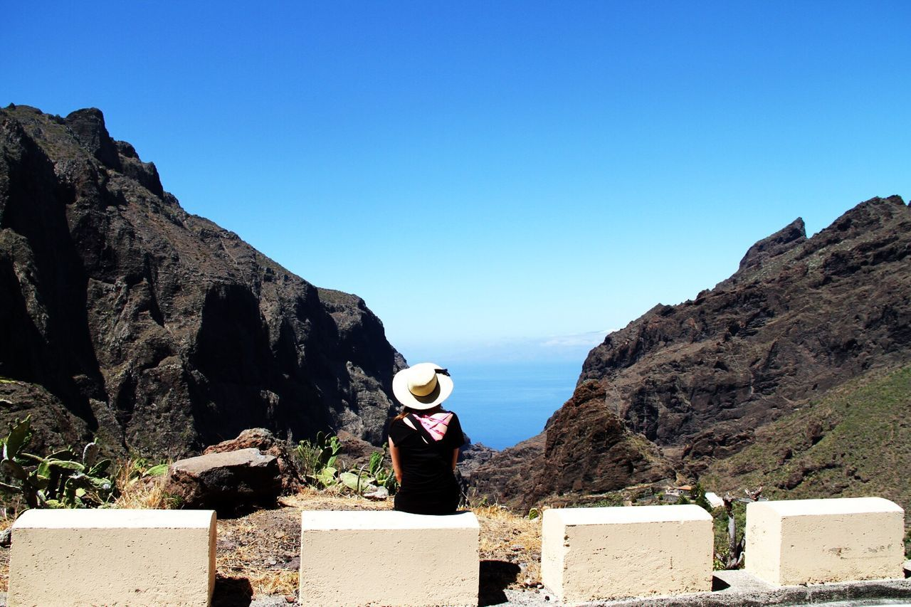 Clear Sky Rock - Object Leisure Activity Blue Day Nature Real People Copy Space Mountain One Person Full Length Sunlight Standing Lifestyles Sky Outdoors Scenics Beauty In Nature Landscape Architecture Tenerife Teneriffa Tenerife Island Mountains Sun The Great Outdoors - 2017 EyeEm Awards Live For The Story