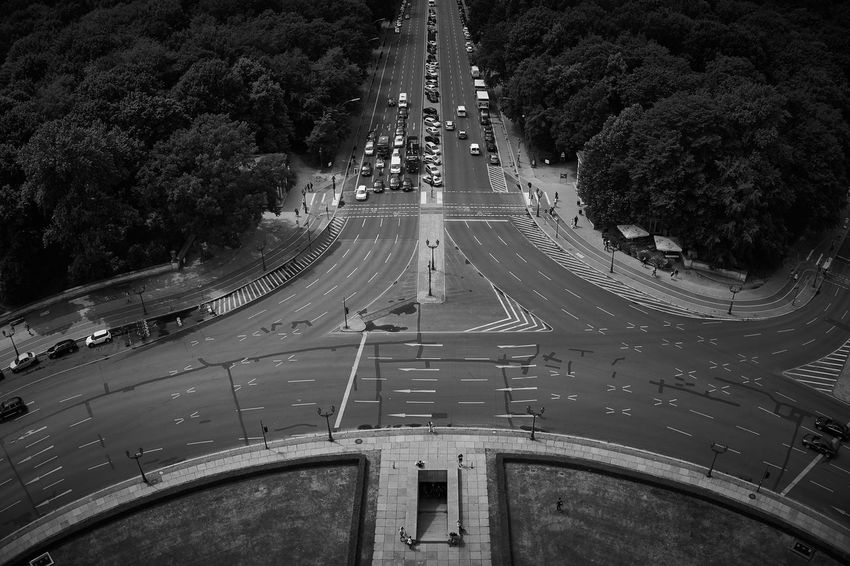 """A Black and White image representing the details of a road next to the """"Siegessäule"""" in Berlin Berlin Black And White Chaos Contrast Crossroads Elevated View Germany Light And Shadow Nature No People Park Road Siegessäule  Street Symétrie The Way Forward Traffic Transportation Traveling"""