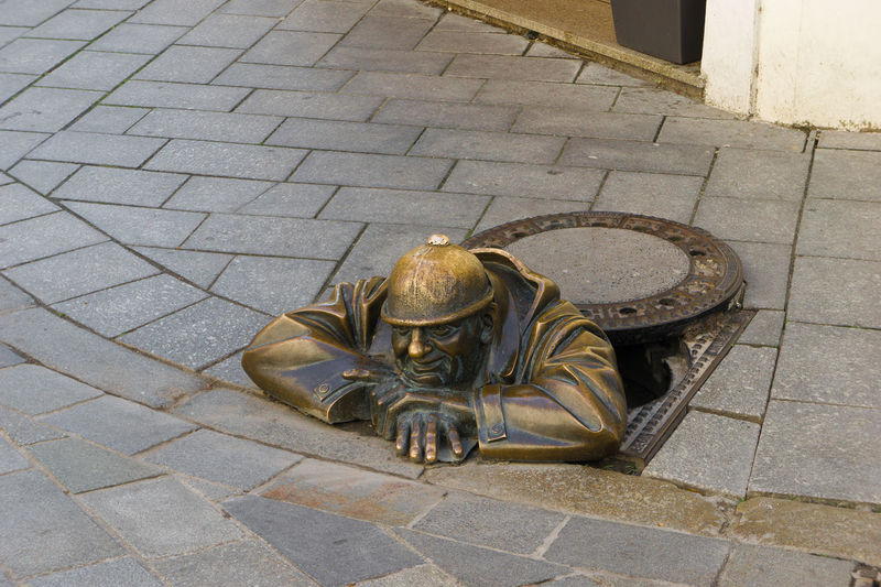 Bratislava, Slovakia sewer cleaner, Cumil, peaking our from a sewer. Architecture Art And Craft Bratislava, Slovakia Building Exterior Built Structure Cobblestone Cumil Day Footpath High Angle View Human Representation One Animal Outdoors Pavement Paving Stone Sculpture Sewer Cleaner Sidewalk Statue Statue Street Wildlife