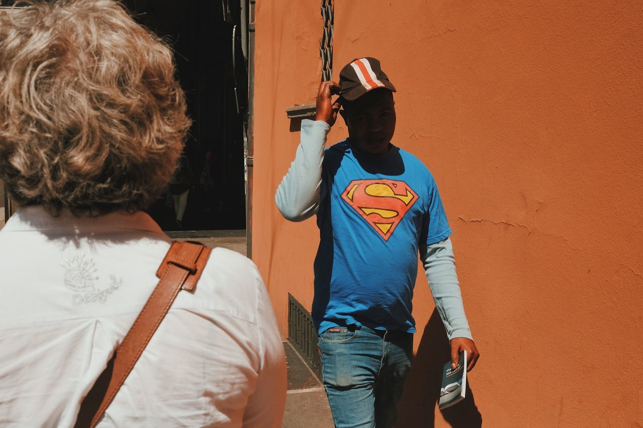 Superheroes have good manners. Real People Two People Rear View Leisure Activity Boys Togetherness Casual Clothing Childhood Day Men Outdoors Lifestyles Standing Bonding Architecture People The Street Photographer - 2017 EyeEm Awards BYOPaper!