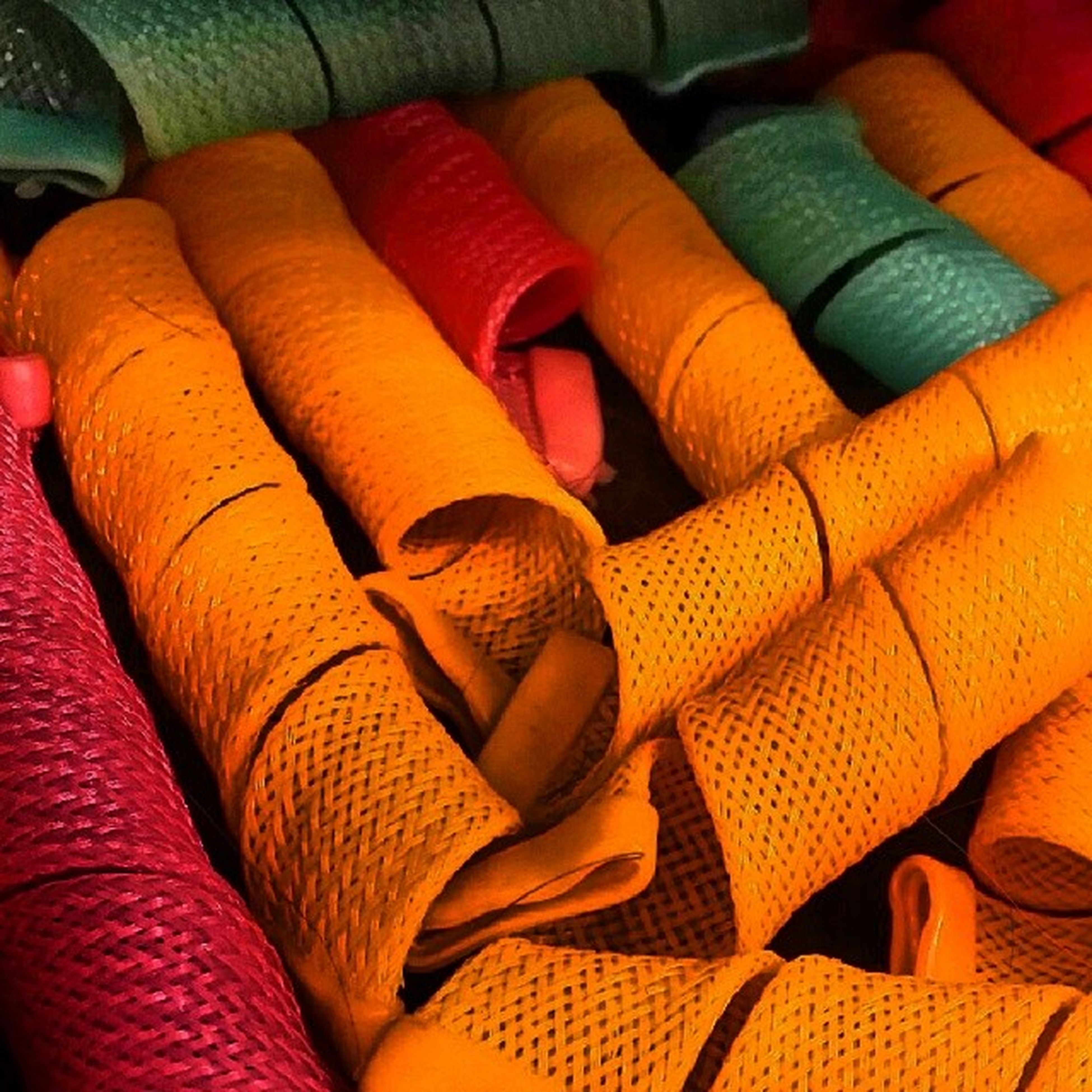 indoors, textile, high angle view, fabric, close-up, person, low section, bed, part of, full frame, multi colored, backgrounds, relaxation, red, pattern, abundance, material