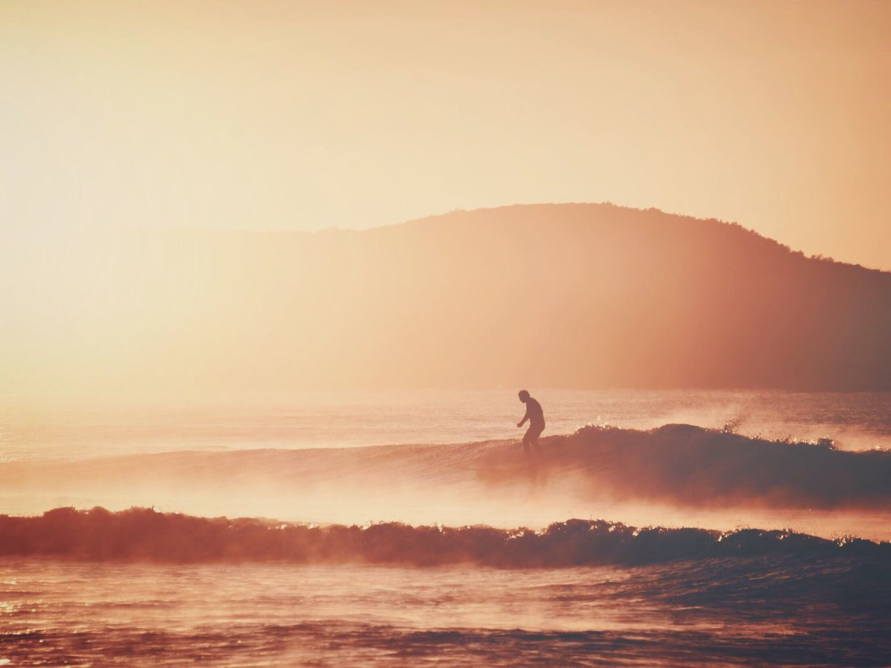 Real People Sunset Water Nature One Person Leisure Activity Beauty In Nature Silhouette Sea Outdoors Waterfront Men Scenics Standing Lifestyles Wave Extreme Sports Mountain Clear Sky Day Surfing Surfer Surf