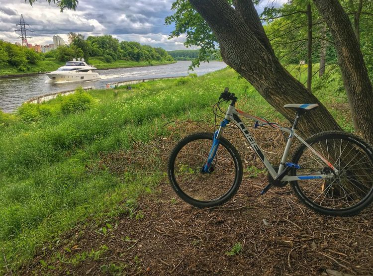 Cube Beauty In Nature Bicycle Bike Cubebikes Day Field Grass Green Color Growth Mode Of Transport Nature Nautical Vessel No People Outdoors Scenics Sky Tranquil Scene Tranquility Transportation Tree Water