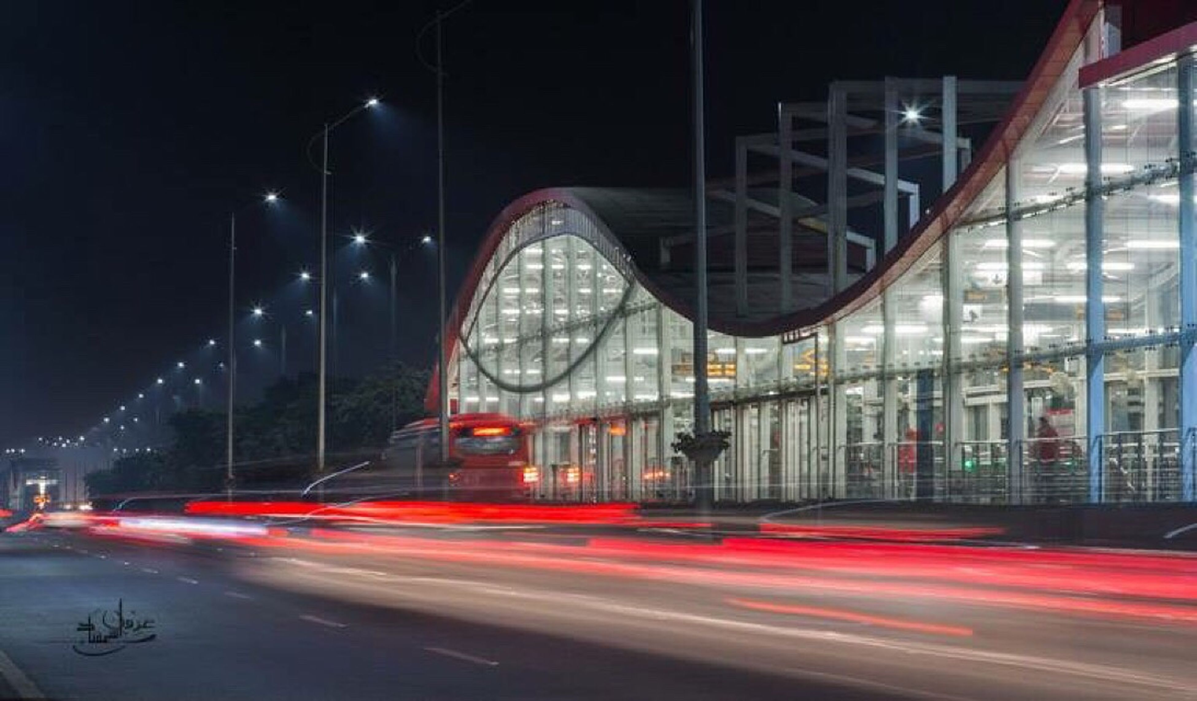 illuminated, night, long exposure, light trail, architecture, transportation, built structure, motion, speed, city, blurred motion, building exterior, road, travel destinations, travel, city life, famous place, street, on the move, red