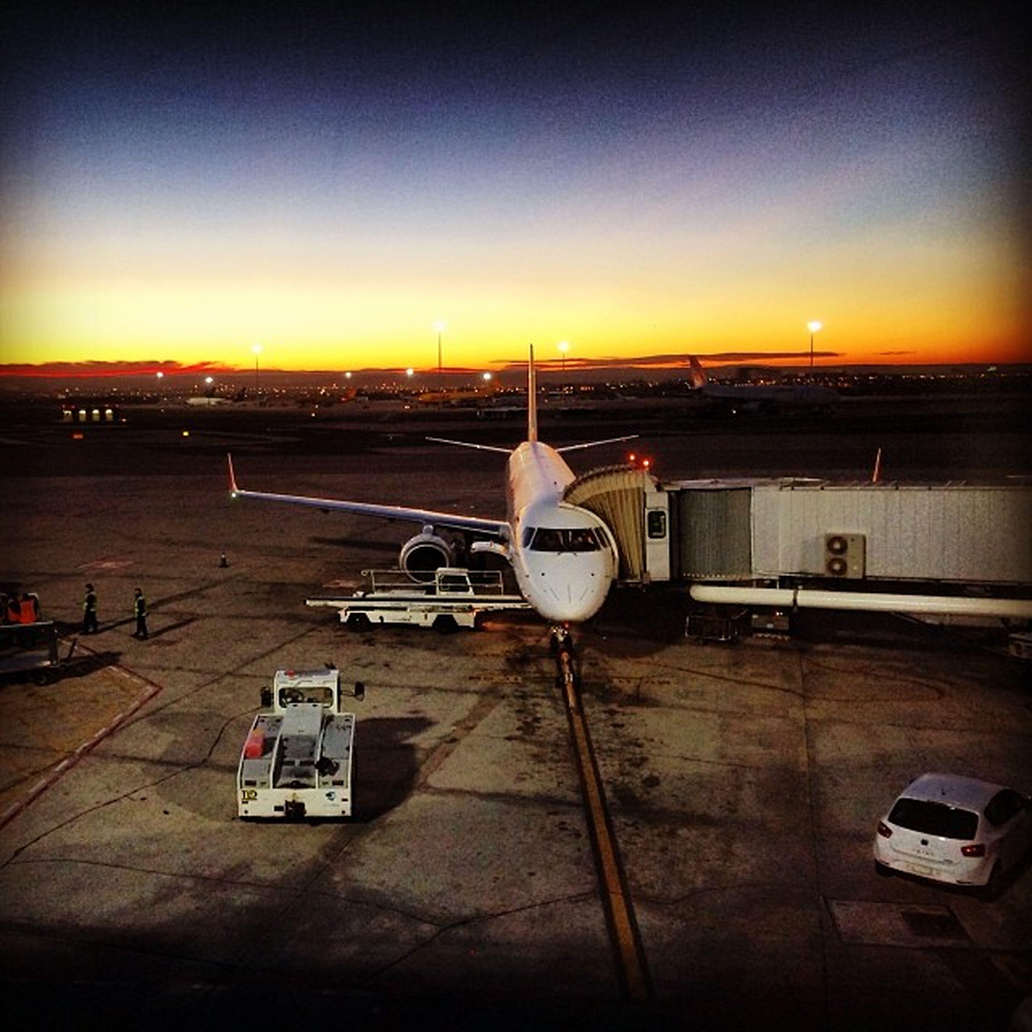 sunset, transportation, mode of transport, orange color, sun, sky, copy space, airplane, nautical vessel, clear sky, travel, sea, car, land vehicle, air vehicle, airport, outdoors, public transportation, sunlight, journey