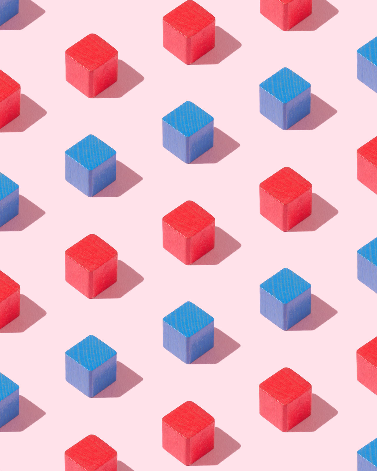 Blue and red wooden cubes organized over pink background Block Blue Color Box Childhood Toys Colorful Colors Conceptual Construction Cub Cubism Geology Harsh Shadow In A Row Object Organized Organized Neatly Pink Background Red Color Shape Square Things Organized Neatly Wood Wooden