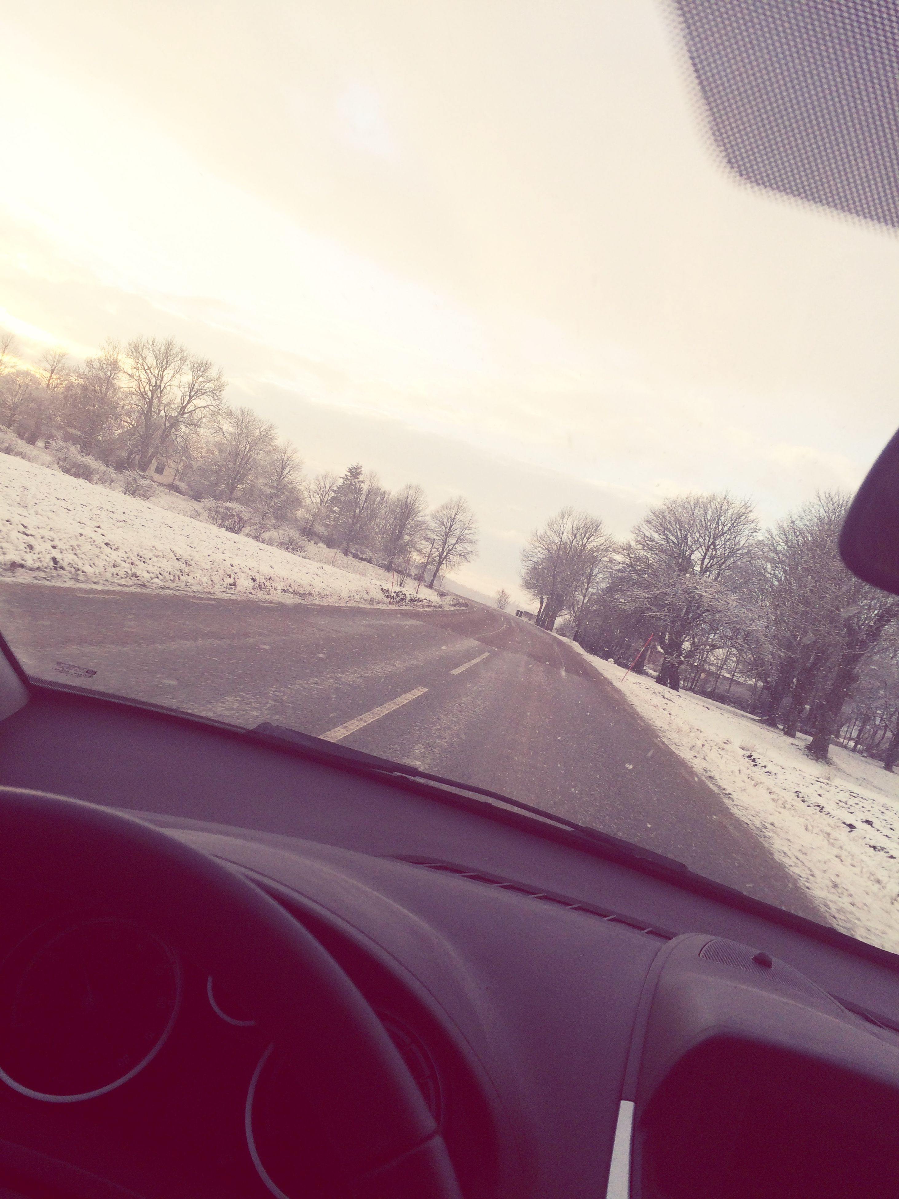 transportation, snow, winter, mode of transport, cold temperature, car, land vehicle, weather, season, vehicle interior, road, windshield, travel, covering, sky, landscape, tree, car interior, part of, white color