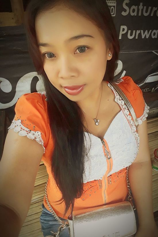 Fresh Orange... Only Women One Woman Only Looking At Camera One Person One Young Woman Only Portrait Adults Only Adult Young Adult People Arts Culture And Entertainment Young Women Beautiful Woman Beauty Smiling Outdoors Day Close-up City Bandungpisan SundaneseFace Strongwife Happiness Love Fun