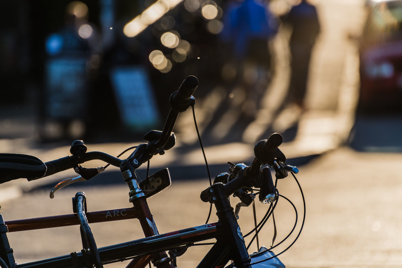bicycle, land vehicle, transportation, mode of transport, focus on foreground, stationary, bicycle rack, no people, day, outdoors, close-up