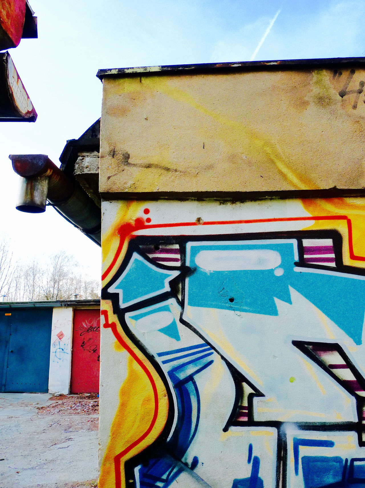 where lines meet Architecture Arrow Blue Building Exterior Built Structure Close-up Communication Corner Day Ecological Interaction Garage Graffiti Gutter Multi Colored No People Outdoors Paint Parallels Pipes Red Sreet Art Yellow