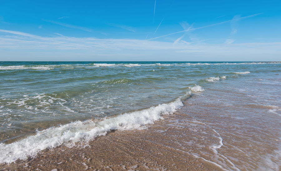 Waves crashing at the beach in Zeeland Beach Life Holidays Netherlands Beach Beauty In Nature Horizon Over Water Nature No People Outdoors Sand Scenics Sea Sky Summer Sylt Tranquil Scene Tranquility Travel Destinations Water Wave Waves Waves, Ocean, Nature Zeeland