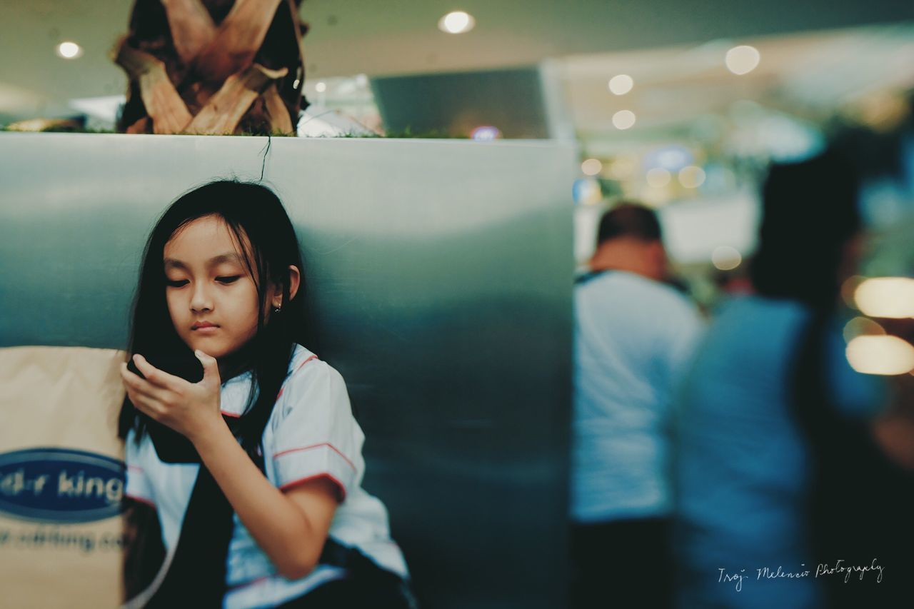 real people, one person, childhood, indoors, focus on foreground, lifestyles, leisure activity, boys, sitting, wireless technology, illuminated, night, close-up, people