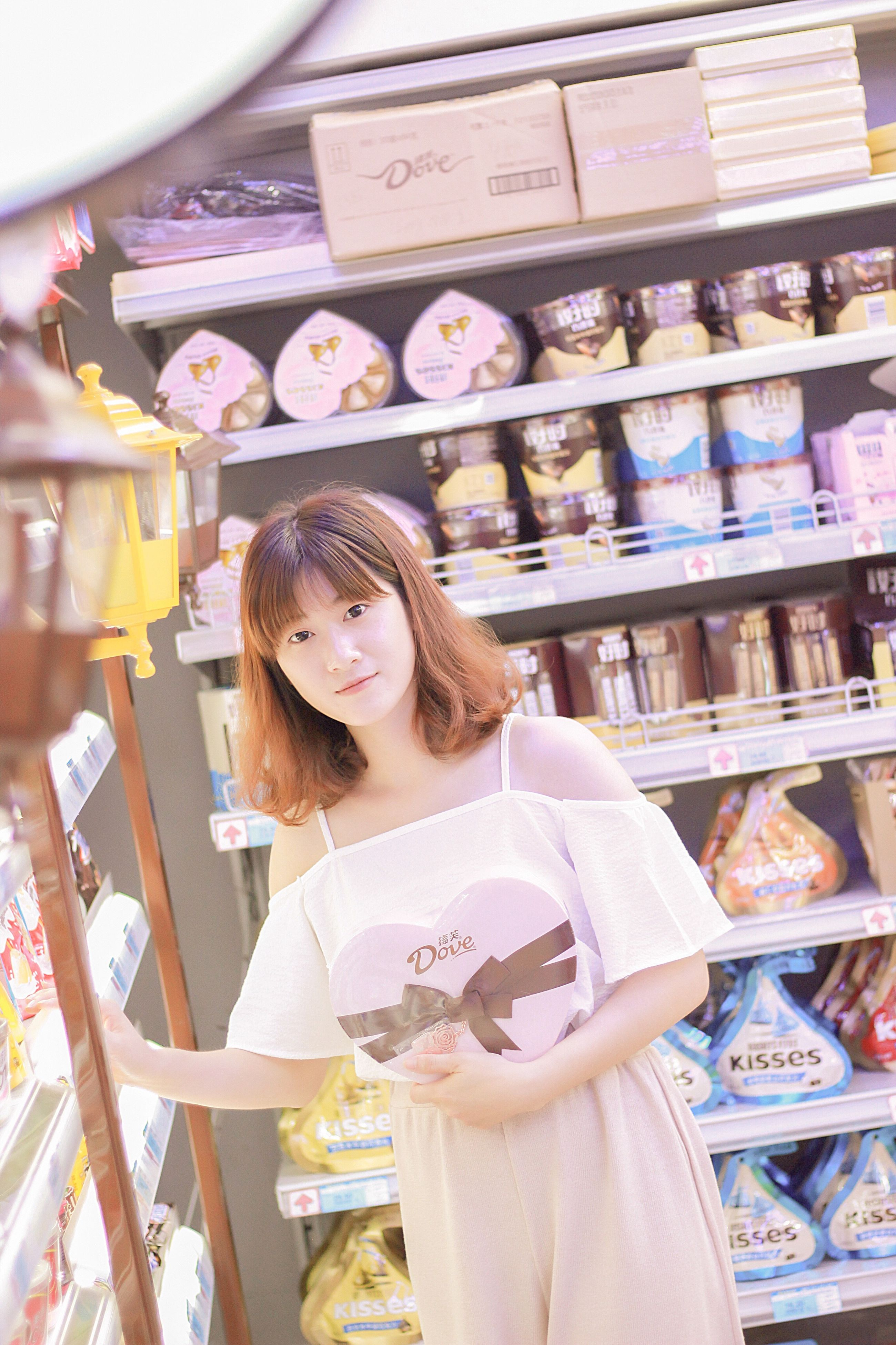 retail, one person, store, shelf, casual clothing, real people, indoors, choice, standing, front view, consumerism, medium-length hair, young adult, variation, lifestyles, young women, customer, day, supermarket, people
