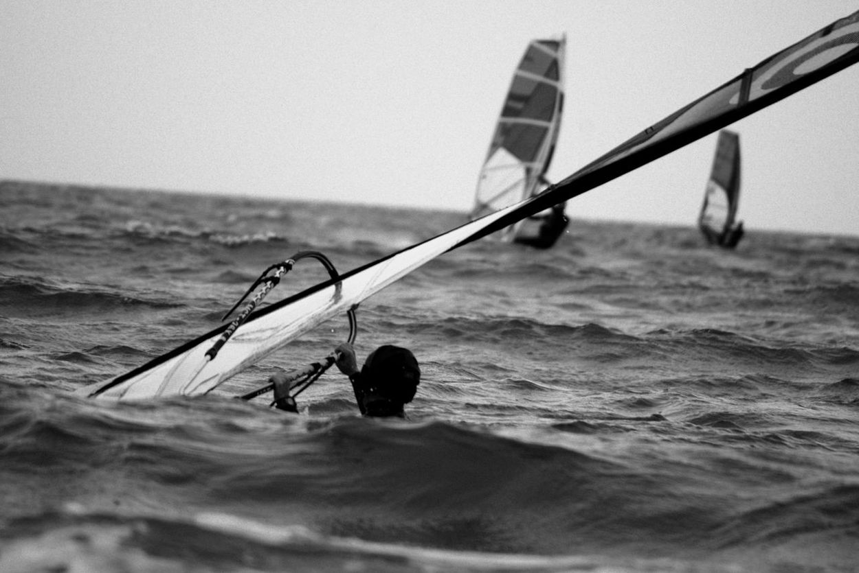 """6/13 ..watching you rebel   """"take a closer look"""".. Black And White Blackandwhite Clear Sky Confidence  Damaged Focus On Foreground Horizon Over Water Leisure Activity Men Monochrome Motion Sea Seaside Visual Thoughts Water Waves"""