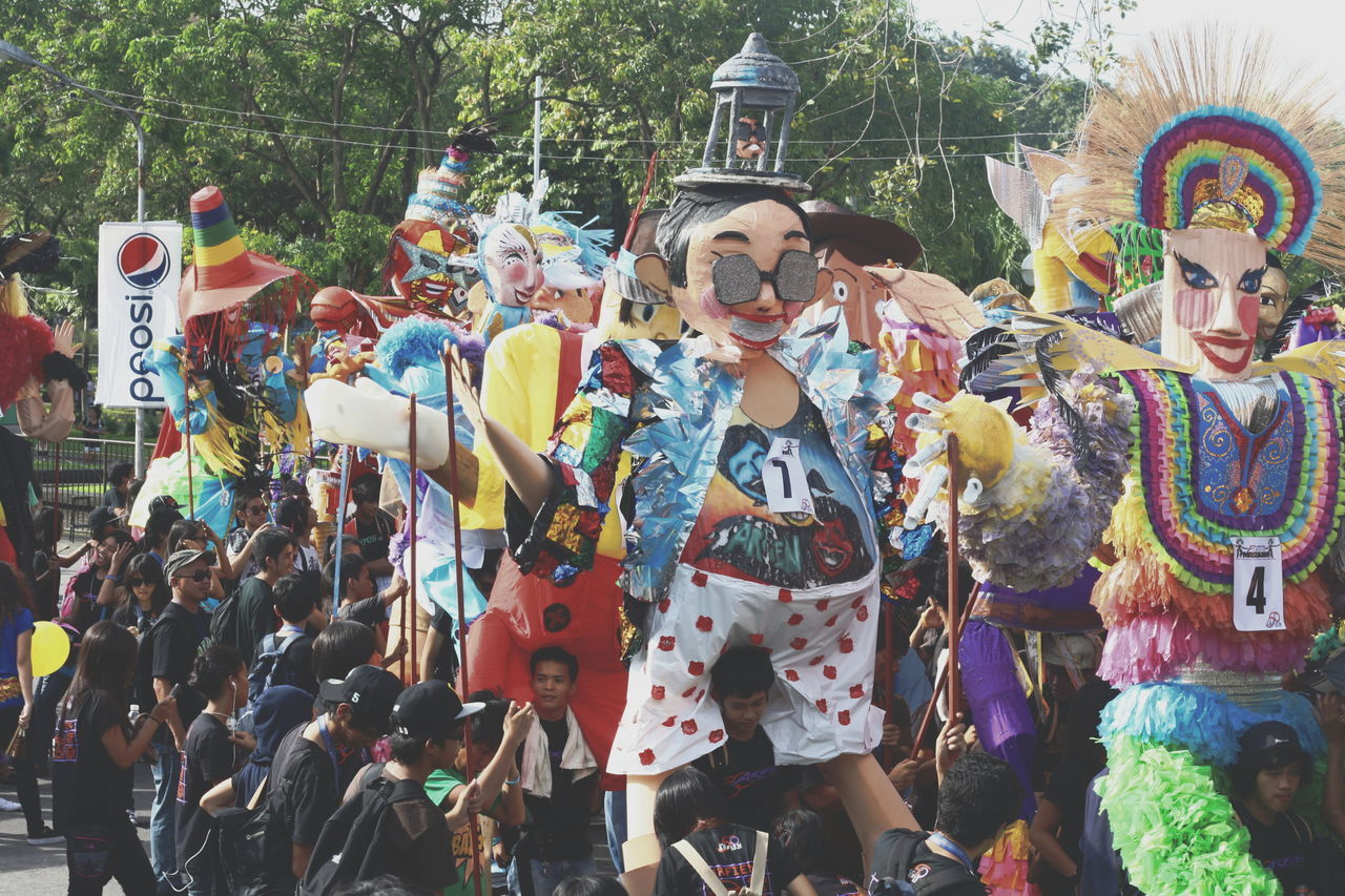 Arts Culture And Entertainment Carry Celebration Costume Crowd Festival Giant Puppets Large Group Of People Masks Masskara Festival Multi Colored Paper Mache Performance Puppets Street Performance The Great Outdoors - 2017 EyeEm Awards The Street Photographer - 2017 EyeEm Awards