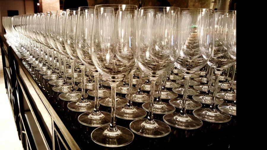 In A Row Illuminated Large Group Of Objects No People Arrangement Indoors  Neat Close-up Day Wine Glass Glass Banquet