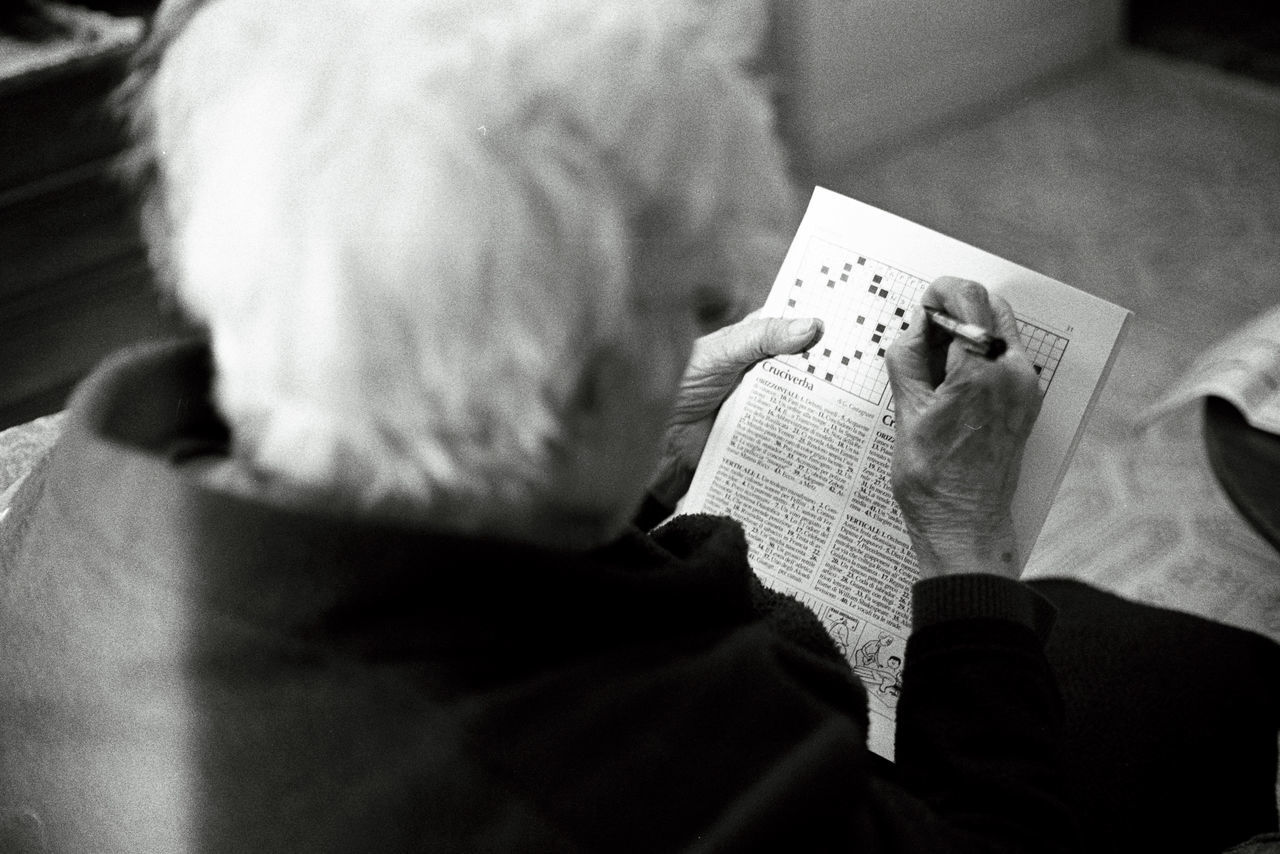 Analogue Photography blackandwhite Crossword elderly woman grandmother hobby house no face one person senior adult senior men