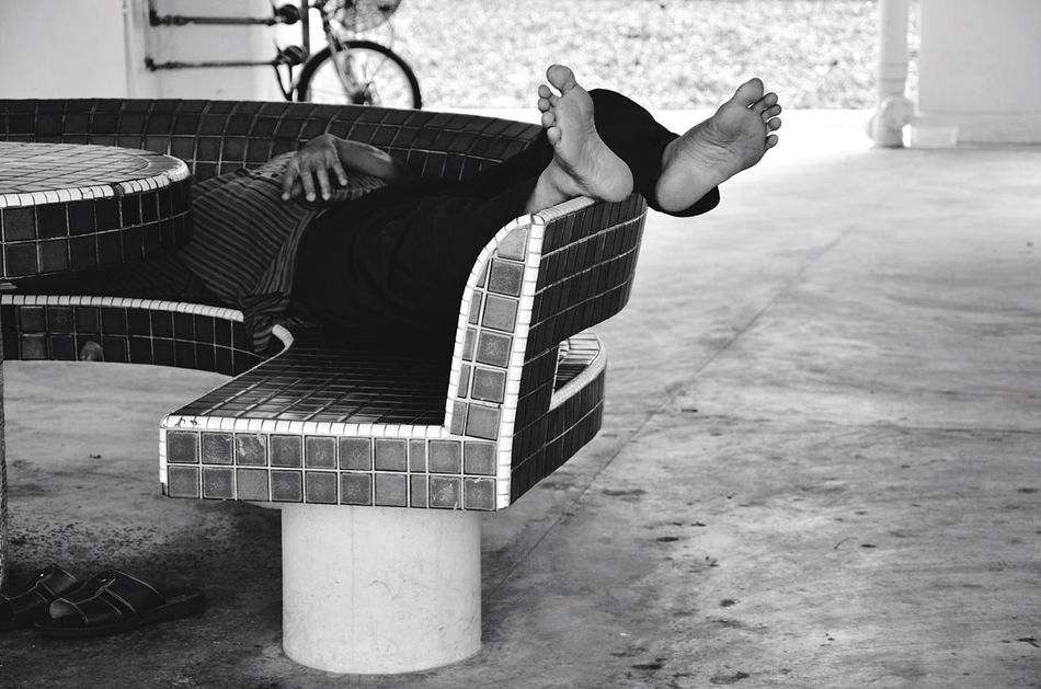 Afternoon nap Sleeping Void Deck Feet Lazy Afternoon HDB Different Perspective Black And White Photography Black And White Collection  Black And White Street Photography