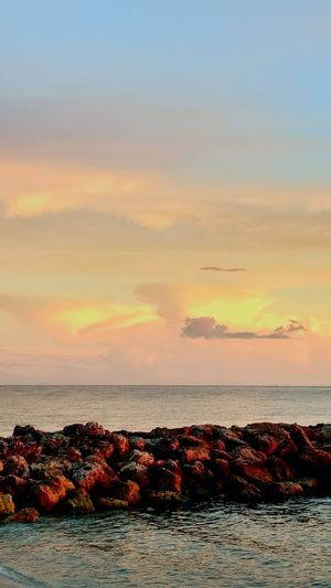 Sunset Sea Sky Beach Cloud - Sky Tranquil Scene Landscape Horizon Over Water Outdoors Sun Beauty In Nature No People Travel Destinations Water Nature Sunlight Seascape Orange Color Dramatic Sky Beauty In Nature Relaxation Rock - Object Waterfront