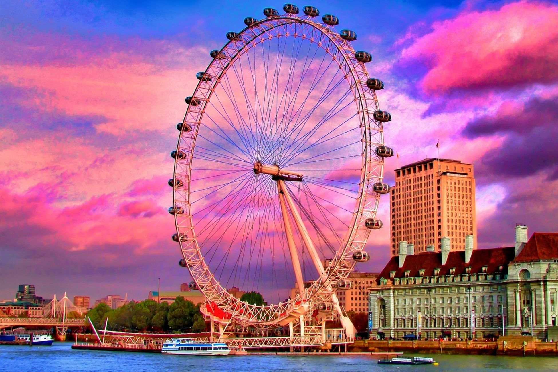 ferris wheel, amusement park, amusement park ride, arts culture and entertainment, sky, built structure, architecture, cloud - sky, fun, water, low angle view, enjoyment, building exterior, travel destinations, millennium wheel, illuminated, fairground ride, leisure activity, big wheel, cloudy