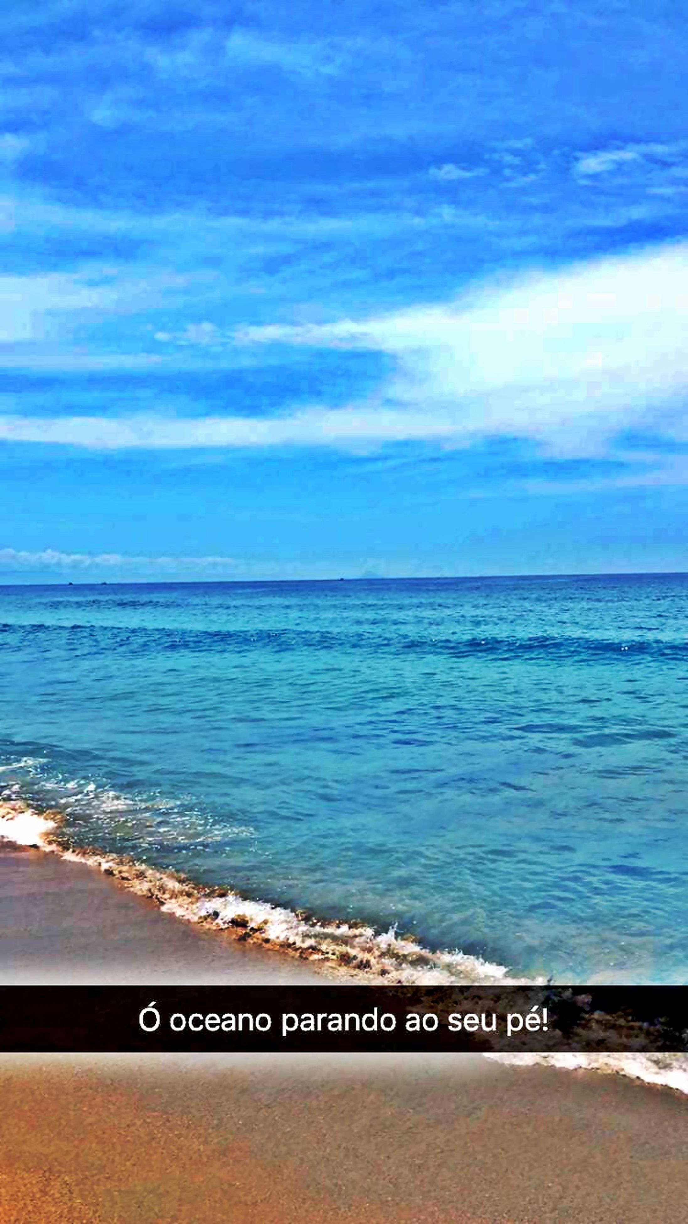 sea, horizon over water, water, beach, sky, shore, scenics, tranquil scene, tranquility, beauty in nature, blue, nature, text, sand, cloud - sky, western script, idyllic, cloud, wave, outdoors