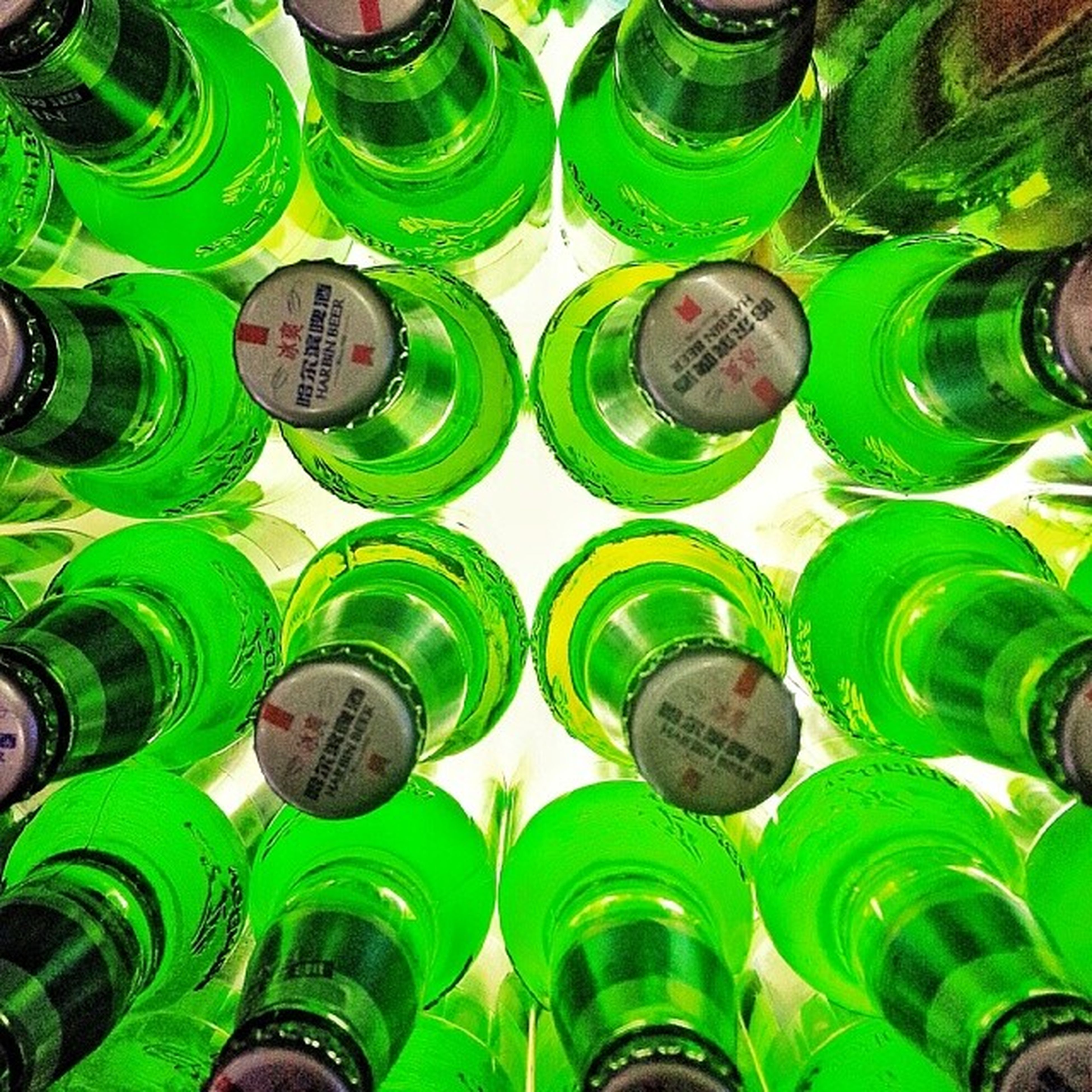 abundance, large group of objects, arrangement, full frame, backgrounds, in a row, variation, order, side by side, repetition, green color, multi colored, choice, high angle view, bottle, indoors, still life, no people, collection, stack
