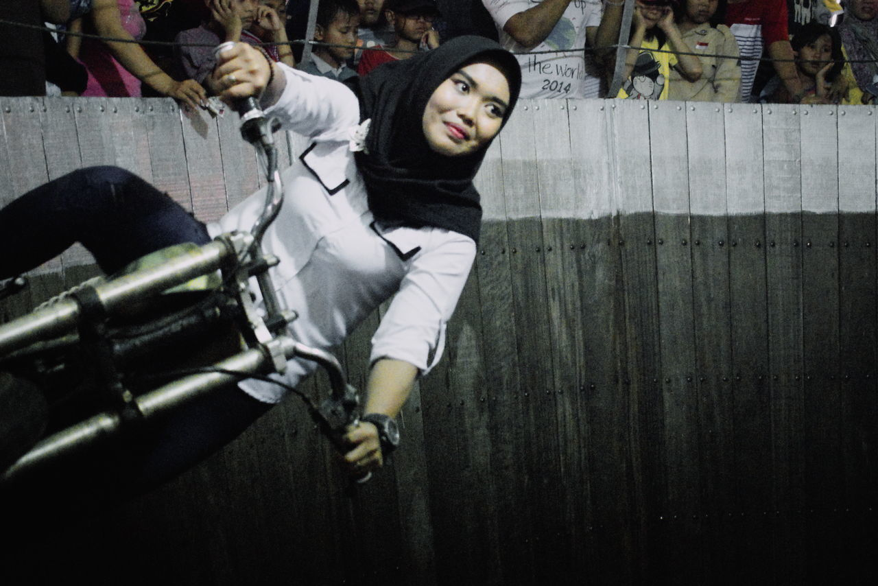 Brave Carnival Culture Daredevil GenderEquality Hijab Leisure Activity Lifestyles Motodrom Motorcycle Night Real People Riding Silhouette Silodrome South East Asia Travel Wallofdeath Wellofdeath Woman Power Young Adult Young Woman