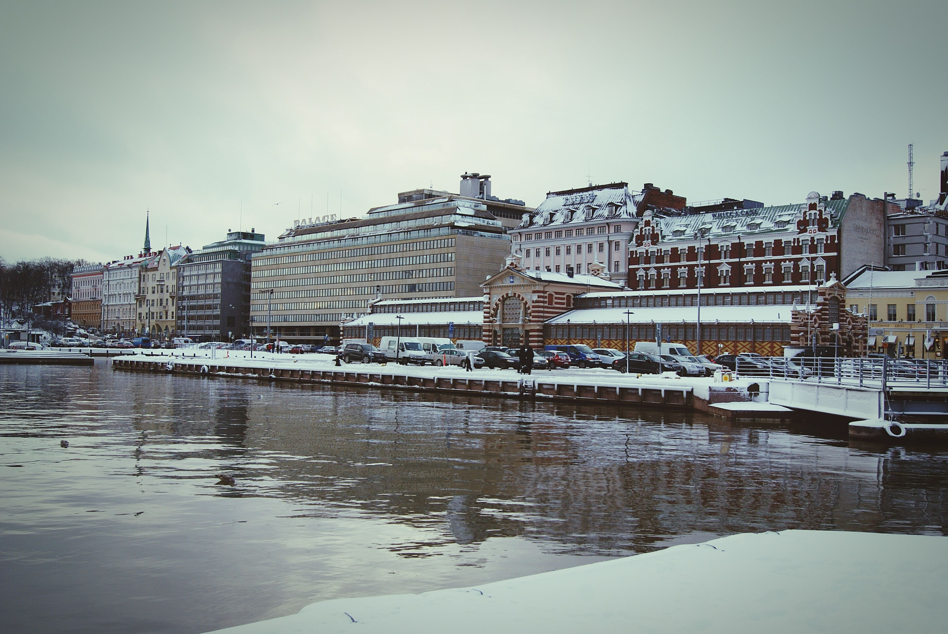 building exterior, architecture, built structure, water, sky, city, reflection, river, waterfront, winter, snow, cold temperature, residential structure, transportation, residential building, building, lake, house, season, weather