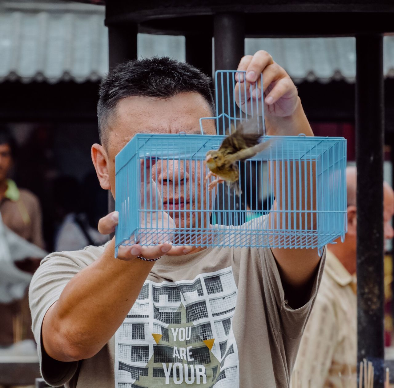 Born to be wild Men Mature Adult Chinese Religious  Cage Bird Flying Flying Bird Uncage Freedom Guy Penang Malaysia Culture Animal Outdoors Streetphotography Street Temple Temple Architecture Adult