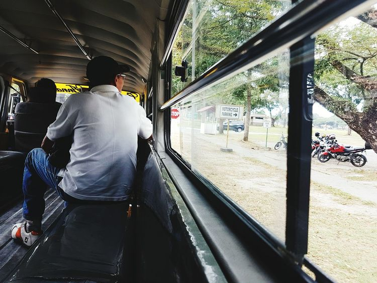 Patiently waiting. Travelling from Mabalacat Public Market somewhere in Clark Business District, this man patiently waiting for his destination. Eyeem Philippines Jeep Life ❤ EyeEm Vision Rear View Window Diminishing Perspective The Photojournalist - 2017 EyeEm Awards