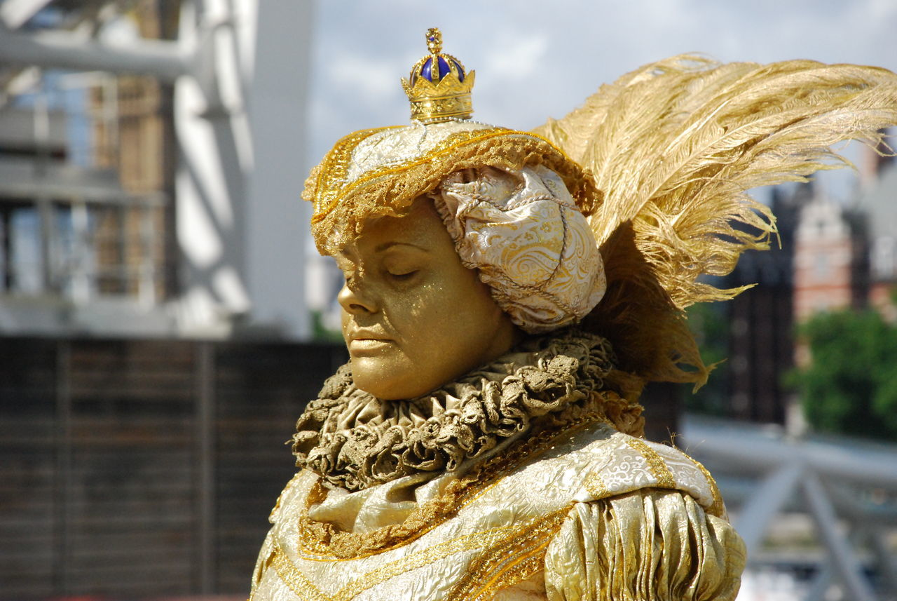statue, gold colored, art and craft, human representation, sculpture, focus on foreground, day, gold, outdoors, no people, golden, close-up