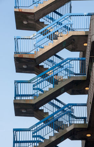 Fire Escape City Clear Sky Day Fire Escape Journey Looking Up No People Outdoors Railing Sky Staircase Steps Steps And Staircases Vertical