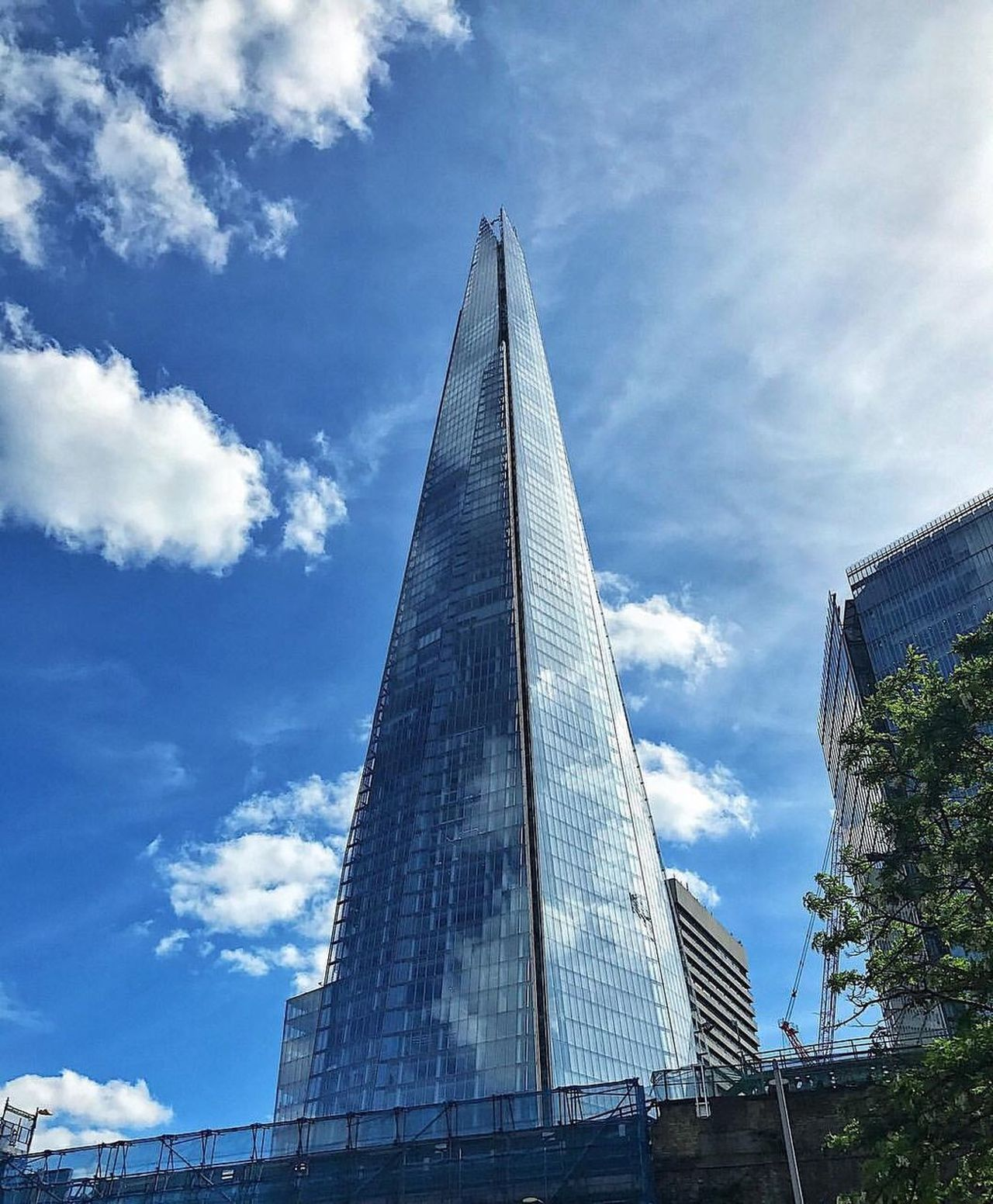 Architecture Sky Built Structure Cloud - Sky Building Exterior Modern Low Angle View Day Skyscraper Travel City Travel Destinations Pyramid No People