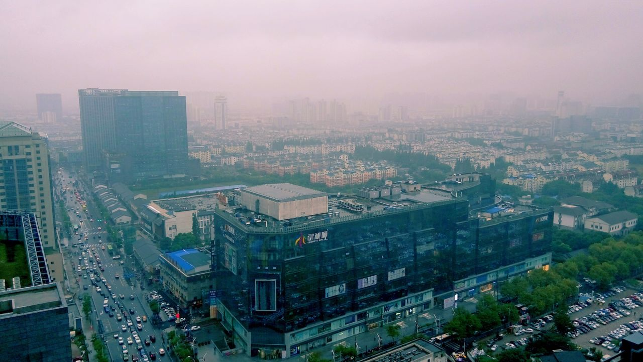 building exterior, architecture, cityscape, city, high angle view, outdoors, fog, no people, aerial view, built structure, skyscraper, day, sky, nature